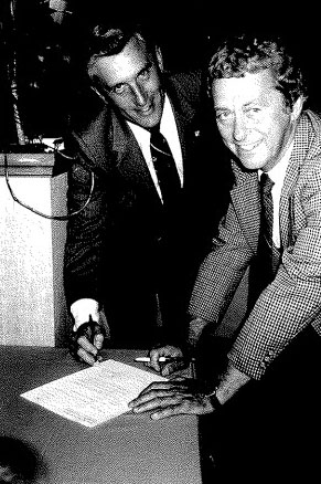 1981        Past President Stan Black with Ken Lajambe signing rights to Bon Soo over