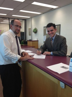 Matthew Shoemaker filing his nomination with Malcolm White, City Clerk earlier this year.
