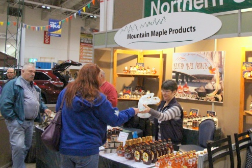 Mountain Maple Products Sue Manchur is ringing up sales of maple syrup products at the 2014 Royal Agricultural Winter Fair. Maple Mountain of St. Joseph Island is one of the many exhibitors in the FedNor-supported Northern Ontario Agri-food Pavilion. This year's edition of the fair runs November 7-16 and attracts more than 320,000 visitors, providing the Northern Ontario businesses with an opportunity to showcase their products and services, develop new markets, and boost sales.