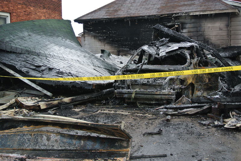 Not much left of the garage or the vehicle