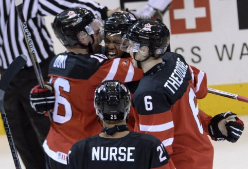 Team Canada's Anthony Duclair, centre, is congratulated by teammates Max Domi, left, and Shea Theodore after scoring against Team Russia during first period gold medal game hockey action at the IIHF World Junior Championship. THE CANADIAN PRESS/Nathan Denette