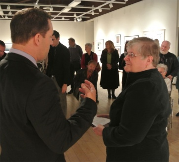 Sandra Houston accepts the award at the Art Gallery of Algoma with friends and family in attendance