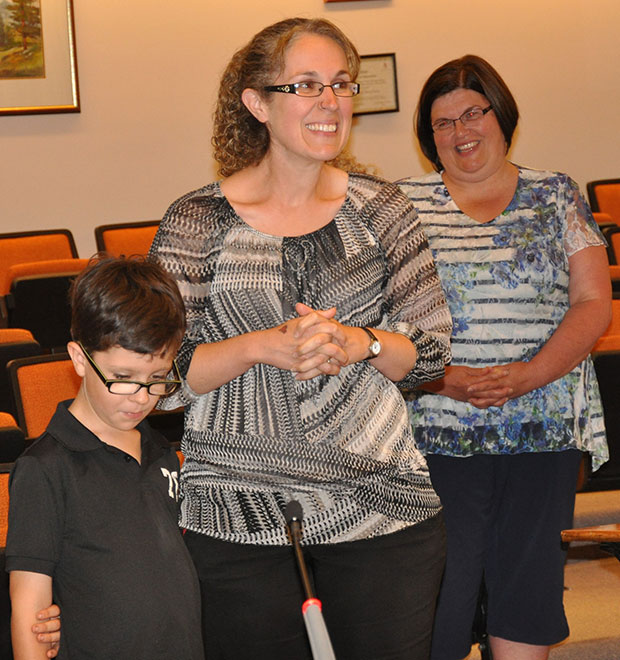 Owen let his mom Shannon do most of the speaking at the Committee of the Whole Meeting.