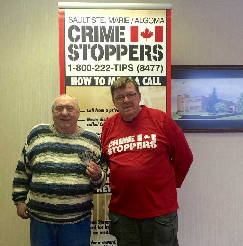 Dennis Murphy (2nd prize winner), and Tom Burmaster, President of the Board of Directors for Crime Stoppers of Sault Ste. Marie & Algoma District.