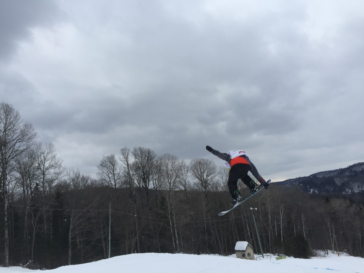 Carter Ianni, first place finisher for U12 boys, performs a nose grab on his snowboard.
