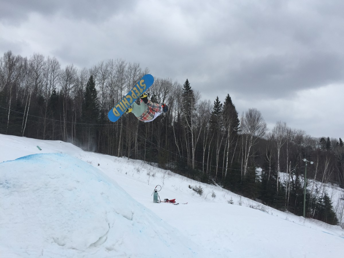 Marc Gratton, spins while airborne off the course's final jump. He placed first in the men's open category.