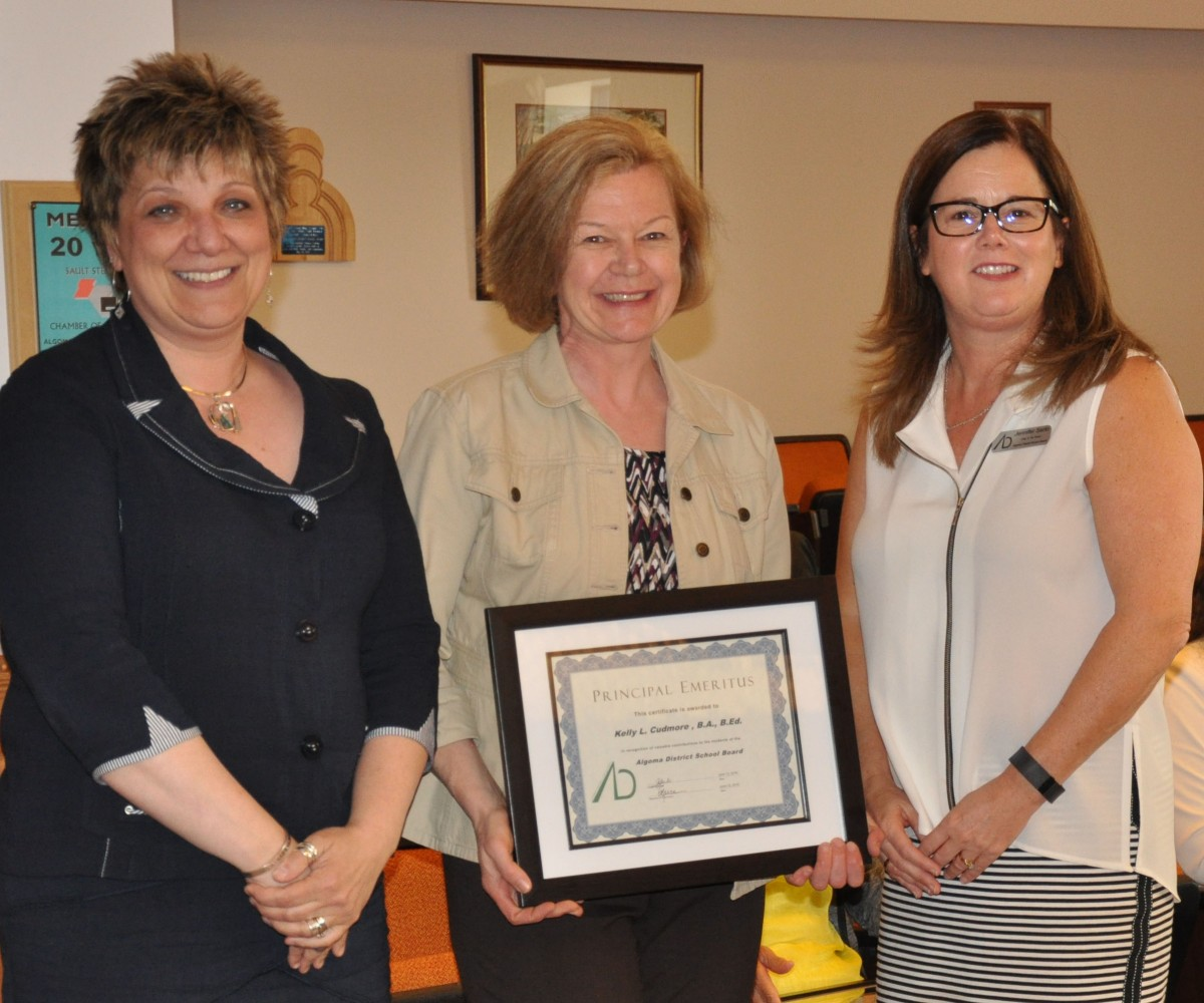 Director Reece (left) and Chair Sarlo (right) thank Kelly Cudmore, retiring Principal of St. Joseph Island Central Public School.