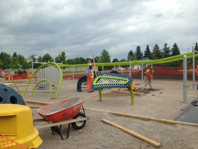 Crews continue to put the finishing touches on the playground