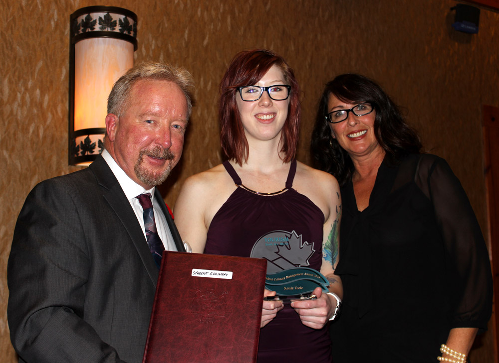 Sault College student Sandy Toole (centre) is presented with the Student Culinary Management Award and $500 Scholarship