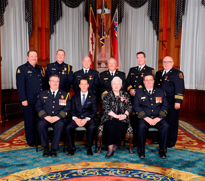 Front Row (Left to right): Fire Chief Larry Brassard, Gravenhurst Fire Department, Hon. David Orazietti, Minister of Community Safety and Correctional Services, Hon. Elizabeth Dowdeswell, Lieutenant Governor of Ontario, Interim Fire Chief, Matthew Pegg, Toronto Fire Services.   Back Row [all recipients] (left to right): Firefighter Bill Brazeau and Firefighter Ryan Brazeau, Gravenhurst Fire Department, Firefighter Dave Archer, Toronto Fire Services, Fire Chief Brent Marshall, Assistant Deputy Fire Chief Bruce Morrison and Deputy Fire Chief Harry Olivieri, Halton Hills Fire Department.