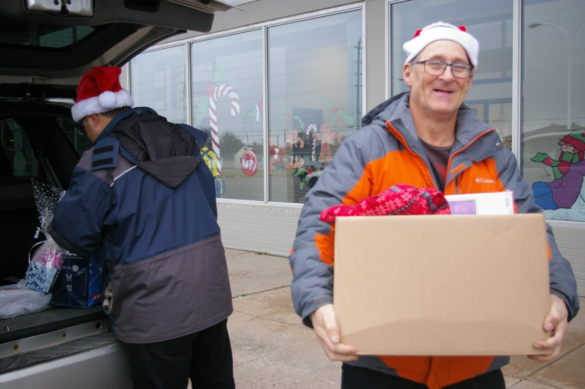 CLA unloading their Christmas Cheer donations at the Christmas Cheer Depot